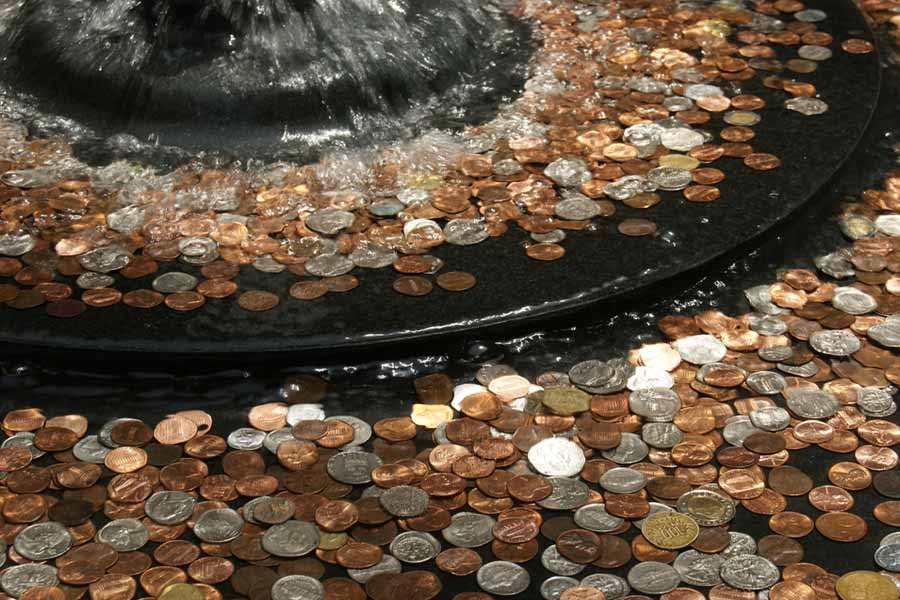 Throwing coins in the fountains or rivers