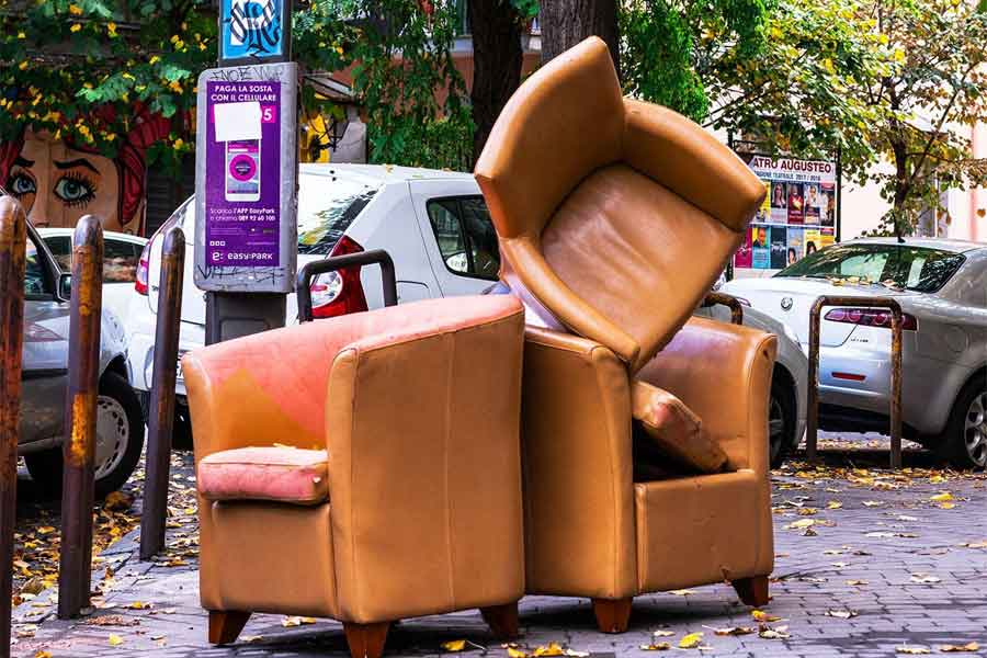 Throwing away furniture out of the window, South Africa