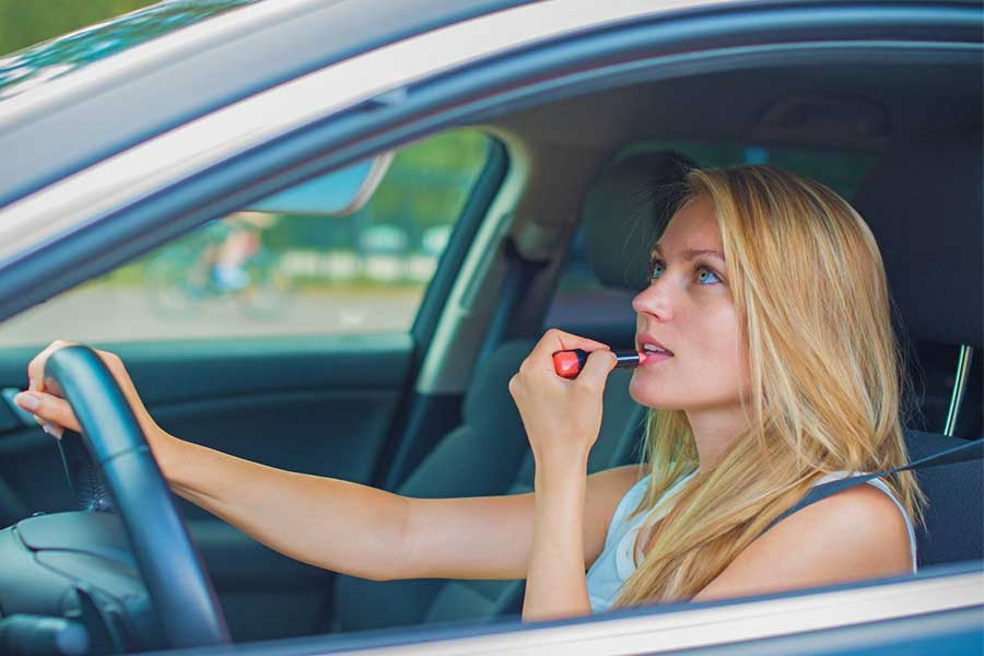 Applying makeup while driving