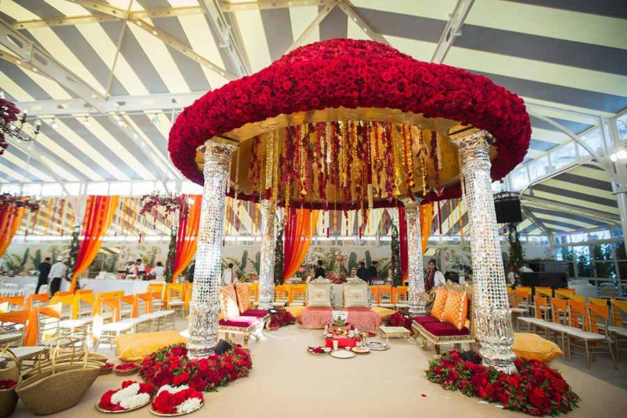 Gorgeous indoor mandap with a floral extravaganza