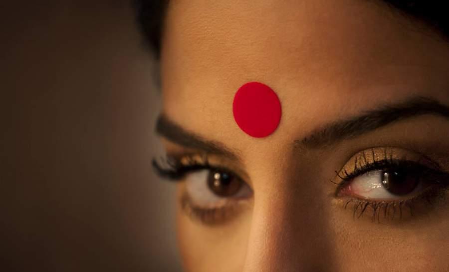 Wearing bindi