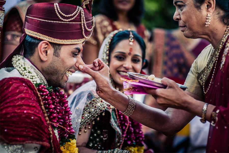 Bride's mother pulls the nose of the groom in Gujarati weddings known as Ponkhana or Ponkvu