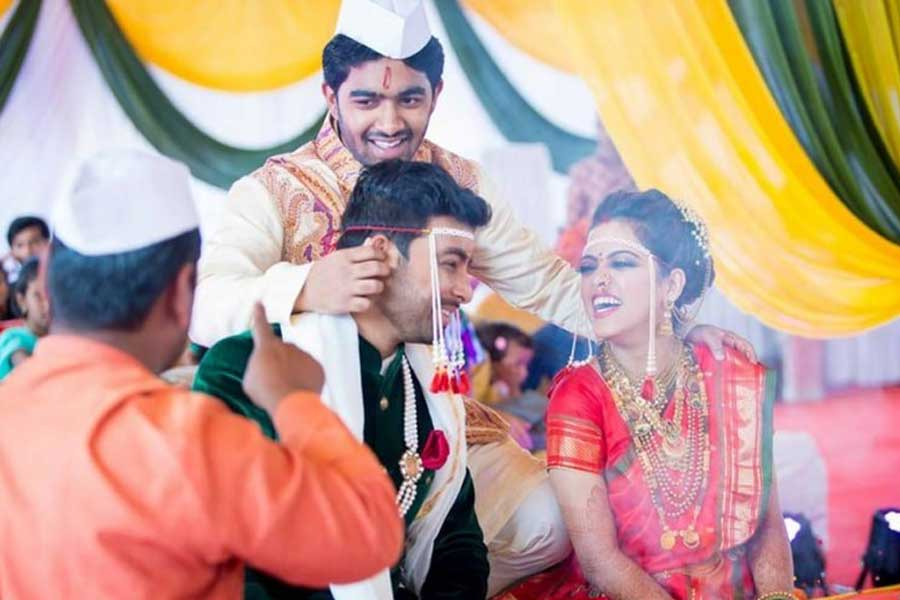 Twisting of groom's ear by the bride's brother in Maharashtrian weddings