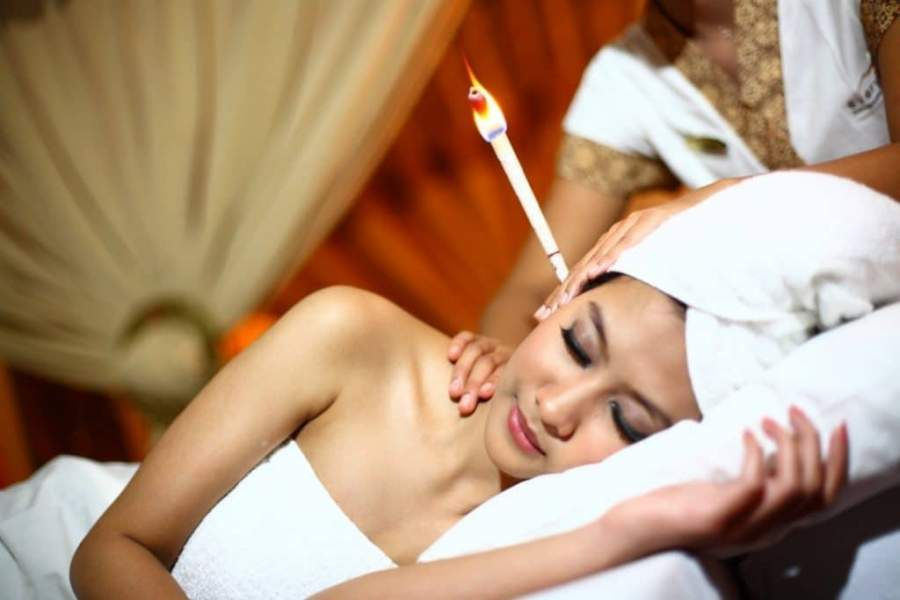 Candling to remove wax from ears