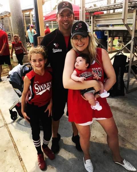 Jamie Watson with wife and kids