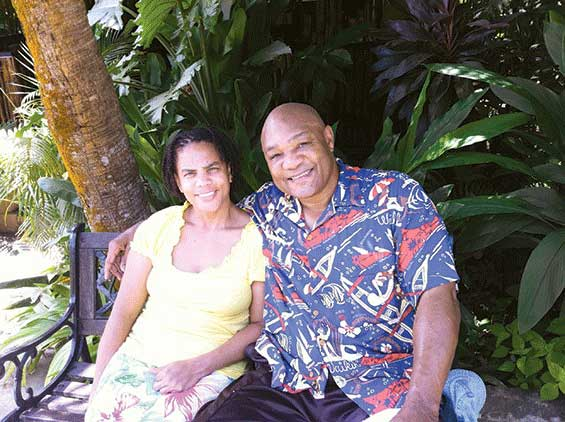 Mary Joan Martelly and George Foreman