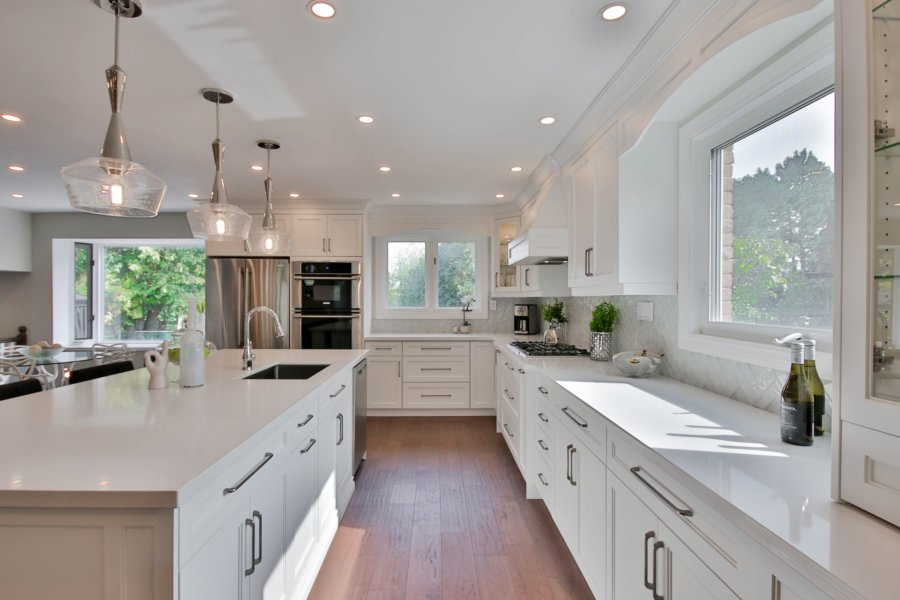 Use a brilliant white color to conceal the outdated cabinet design